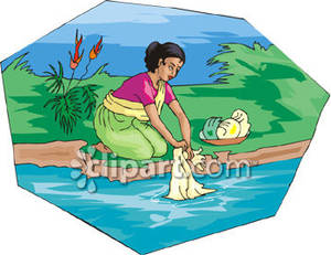 Woman Washing Clothes In the River.