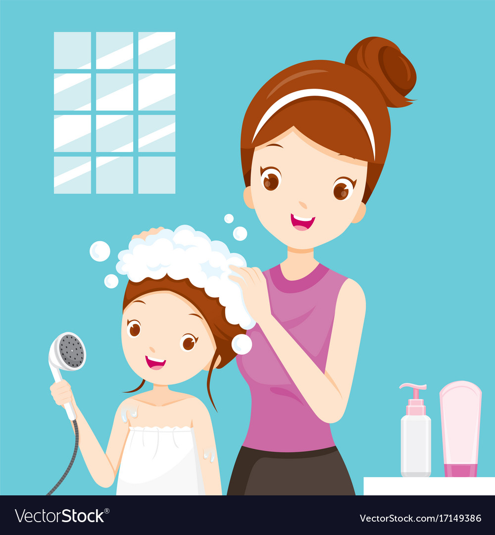 Mother washing daughter hair in bathroom.