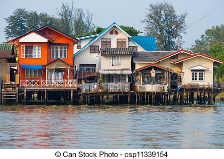 Stock Images of Over Water River Stilt Residential Houses Bangkok.