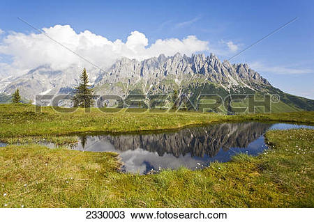 Stock Photo of Reflection of mountains in water, Hochkoenigstock.