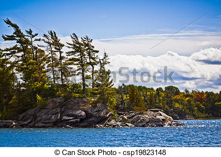 Stock Photo of Georgian Bay Shoreline in Autumn viewed from water.