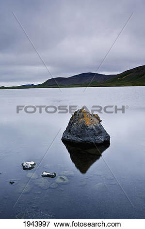 Picture of Tranquil Scene With Rocks In The Water And Mountains.