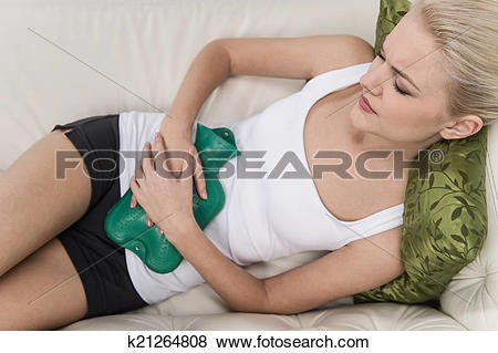 Pictures of Beautiful young woman in bed, with hot water bag on.