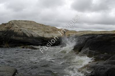 Stock Photography of Water Splash on Rocks.