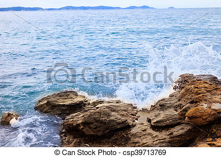 Water splashing. Crystal clear sea water beating against the rocks and  cliffs..