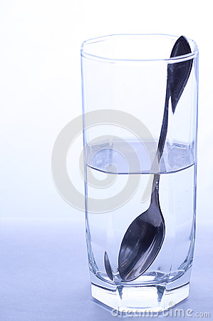 Glass Of Water And Spoon Stock Image.