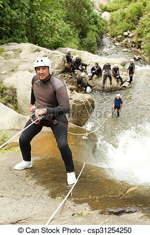 Stock Images of Waterfall Rappelling On Canyoning Adventure.
