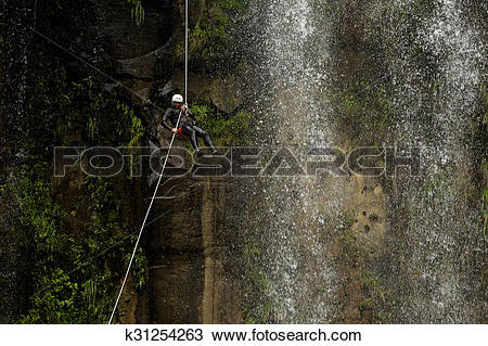 Stock Photo of Waterfall Rappelling On Canyoning Adventure.