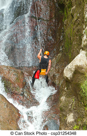 Stock Photo of Rappelling Tall Canyon Waterfall.