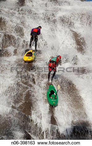 Stock Photo of Two men rappelling down a waterfall near Lake Tahoe.