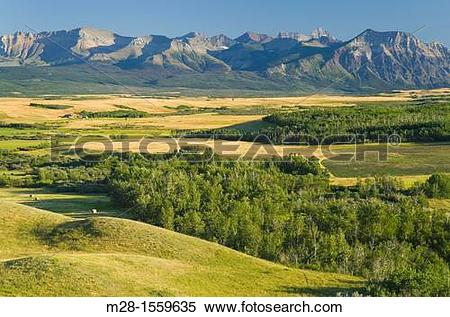 Stock Image of Great Plains prairie meeting the Rocky Mountains at.