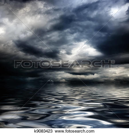 Stock Photo of dark cloudy stormy sky with clouds and waves in the.