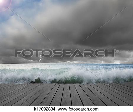 Stock Photo of Pier flooded by waves with cloudy sky, Lightning in.