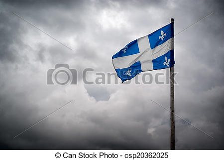 Stock Photo of Quebec Flags Waves Before Stormy, Cloudy Skies.