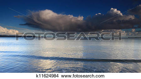 Stock Photo of Clouds and waves k11624984.
