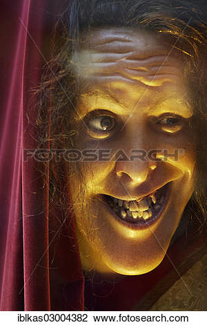 """Stock Photo of """"Face of a grinning wax figure with broken teeth."""