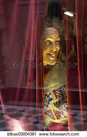 """Stock Photography of """"Wax figure looking through a gap in the."""