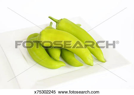 Stock Image of Hot wax chilli peppers on white plate. x75302245.