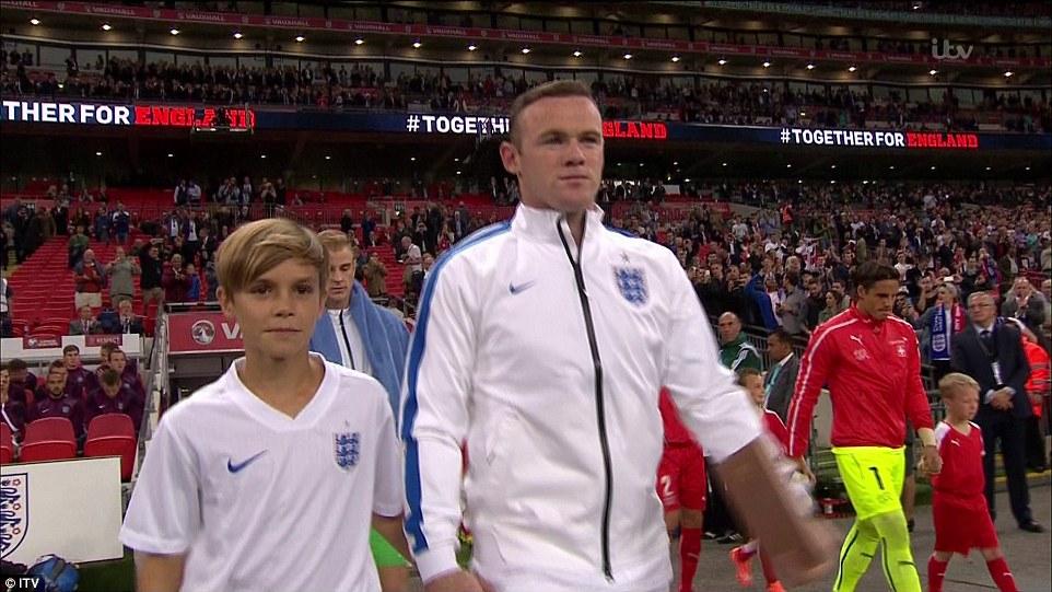 Romeo Beckham leads out England alongside Wayne Rooney as dad.