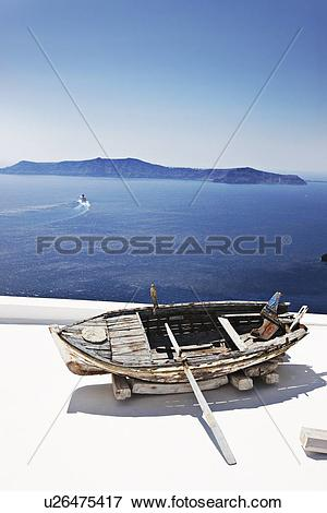 Picture of Weathered wooden boat on balcony u26475417.