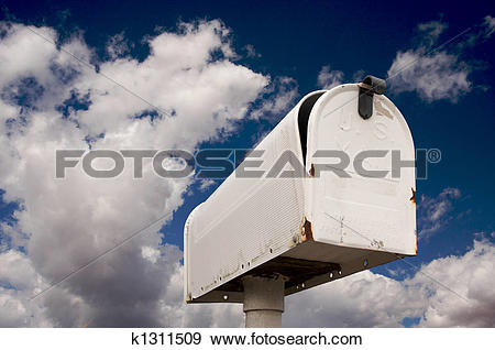 Stock Photograph of Weathered Old Mailbox Against Blue Sky and.