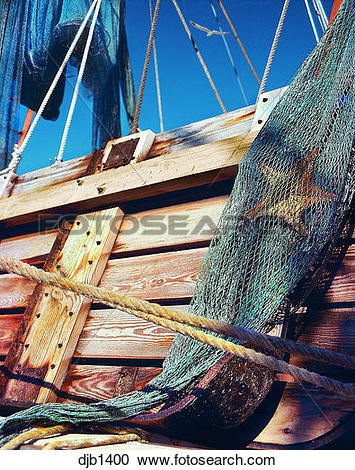 Stock Photography of Maritime scene with weathered wood planks.