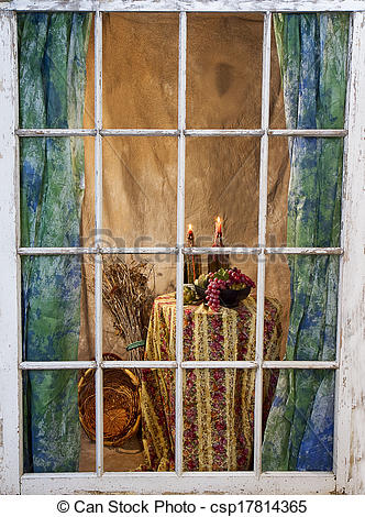 Stock Image of Candles Melting through Old Window.