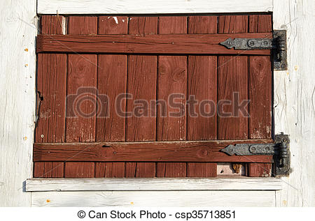 Stock Images of Weathered red plank window shutter.