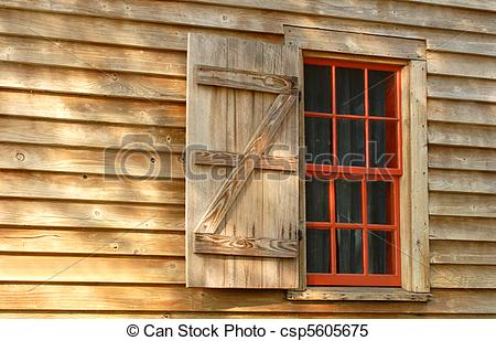 Stock Images of Red window and shutter in a weathered wood.