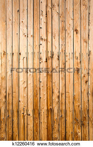 Stock Images of Weathered yellow fence from natural wood, portrait.