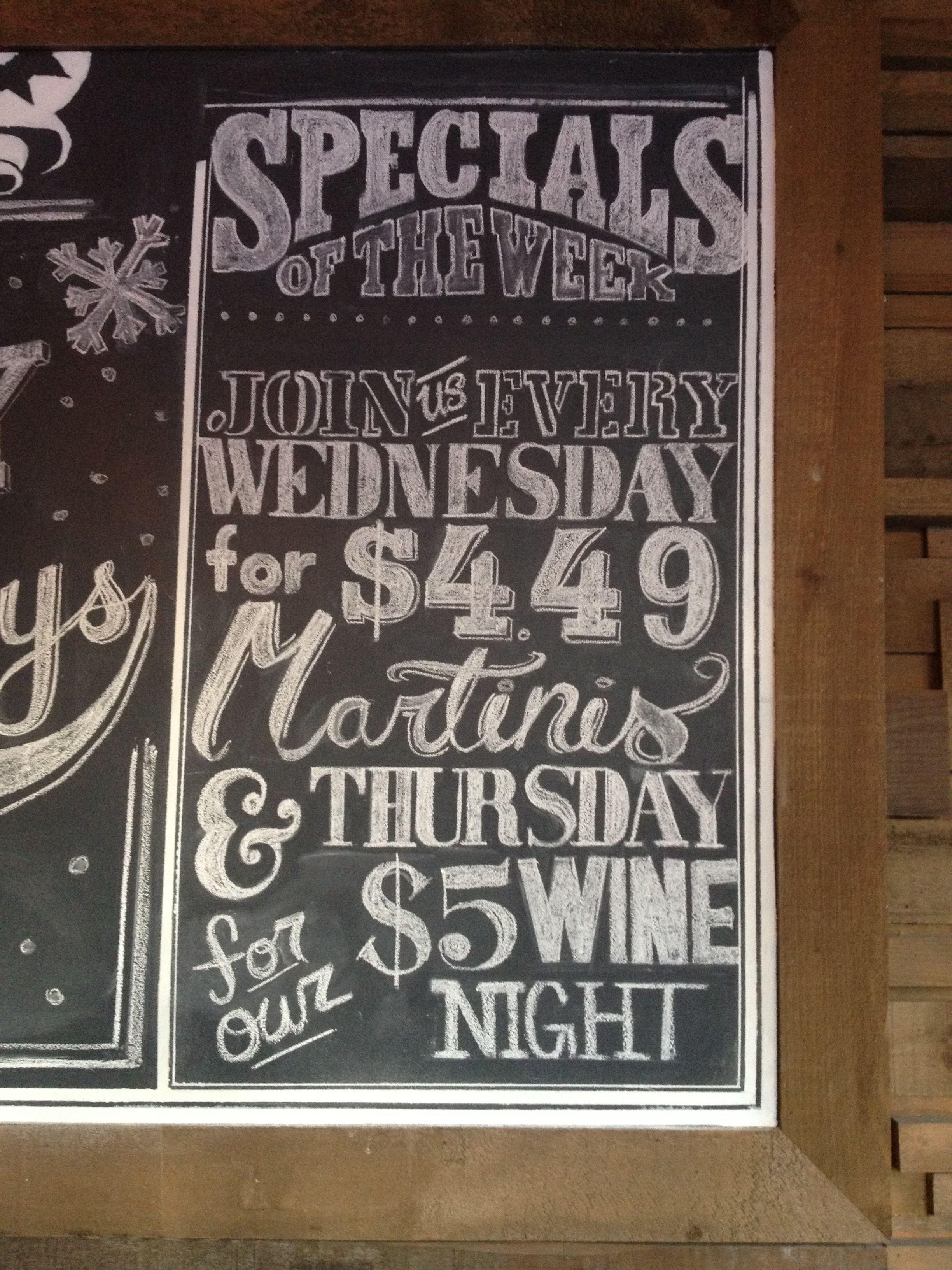 Weekly drink specials board.