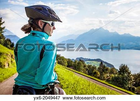 Picture of A woman taking a break while moutain biking in the area.