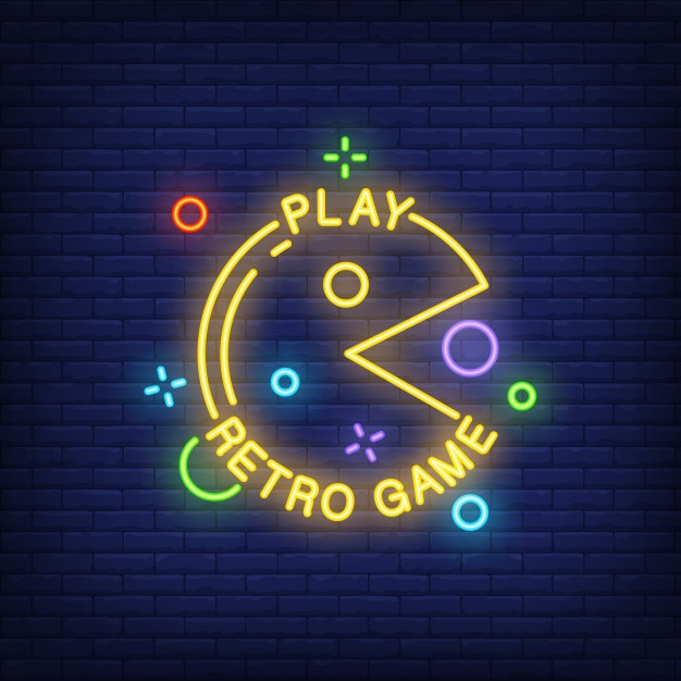 Free Play Retro Game lettering with pacman sign on brick.