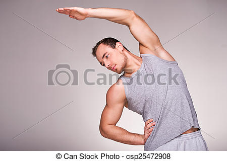 Stock Photography of Well formed man practising sports exercises.