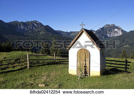 Stock Photo of Small chapel in front of Wendelstein Mountain and.