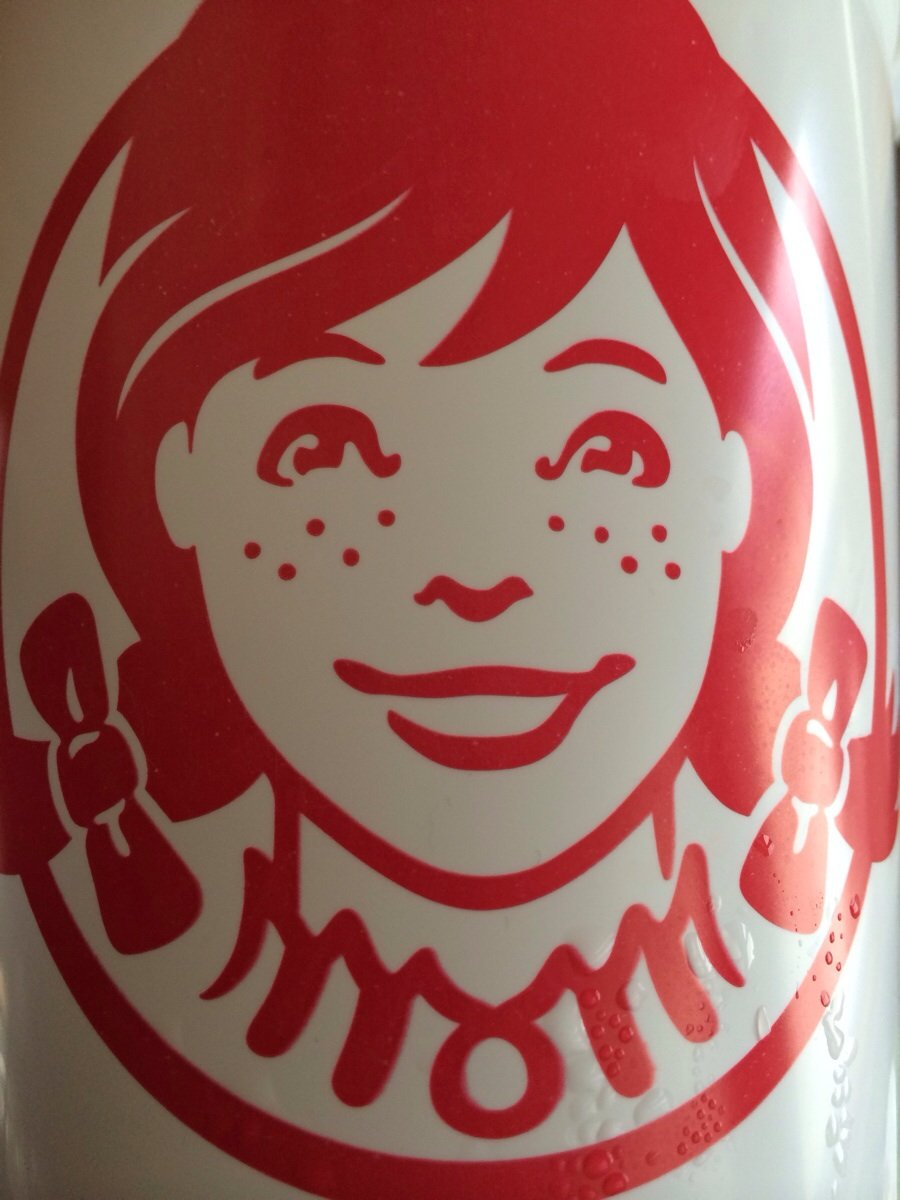 The collar on the Wendy\'s girl logo appears to say \
