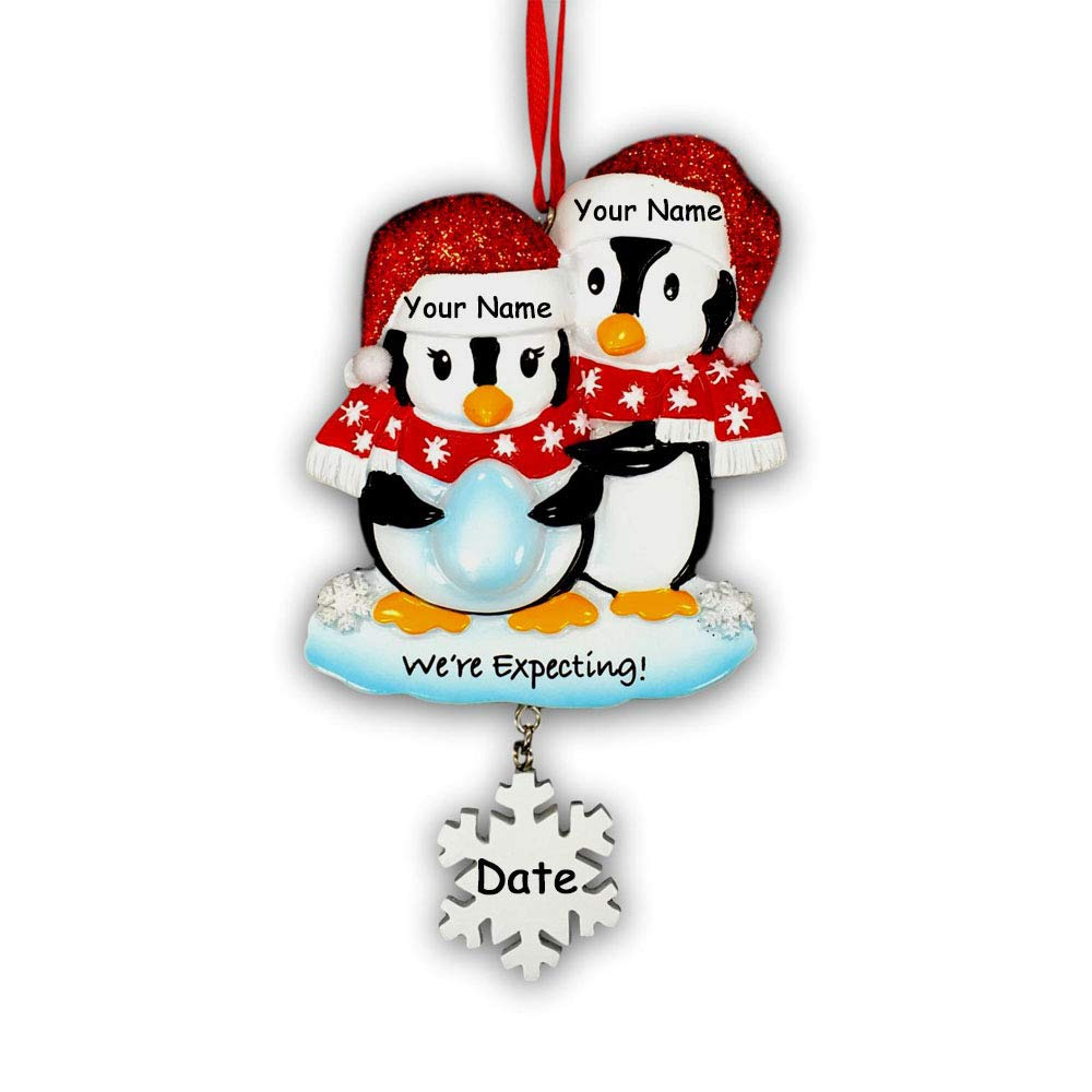 Personalized Pregnant We\'re Expecting Penguin Couple with Baby Egg with  Glittered Santa Stocking Cap and Scarves and Snowflake Detail Hanging.