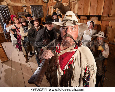 Stock Photo of Trapper in an Old West Bar k9702644.