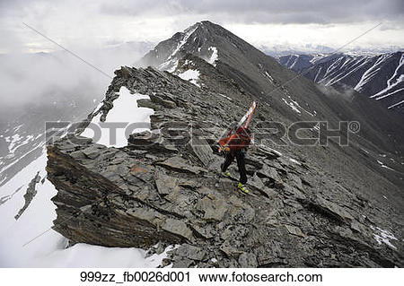 Stock Photography of Backpacker climbs the West Ridge of Mt.