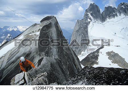 Stock Image of Man rock climbing on Pigeon Spire west ridge.