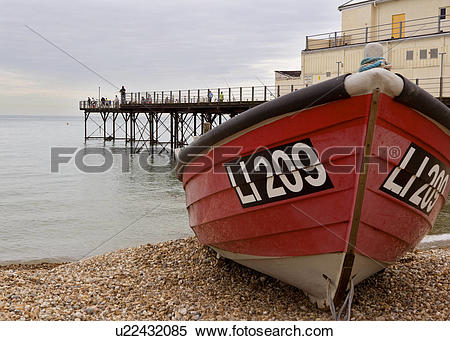 Stock Image of Fishing off the pier in Bognor Regis West Sussex.