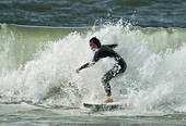 Stock Photo of Young man surfing, Westerland, Sylt, Germany.