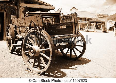 Stock Photo of Antique american cart in old western city.
