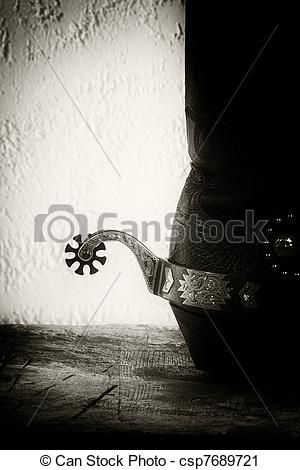 Stock Photography of Shoes and spurs. Retro styled Western still.
