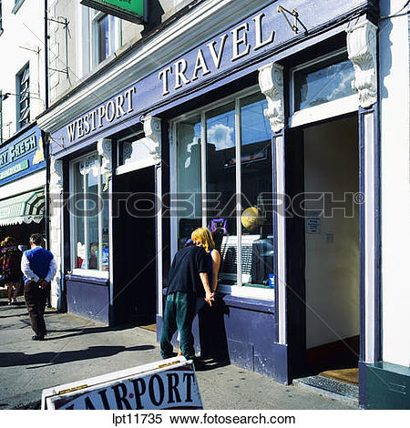 Stock Image of YOUNG COUPLE FLIRTING BY TRAVEL AGENCY WESTPORT.