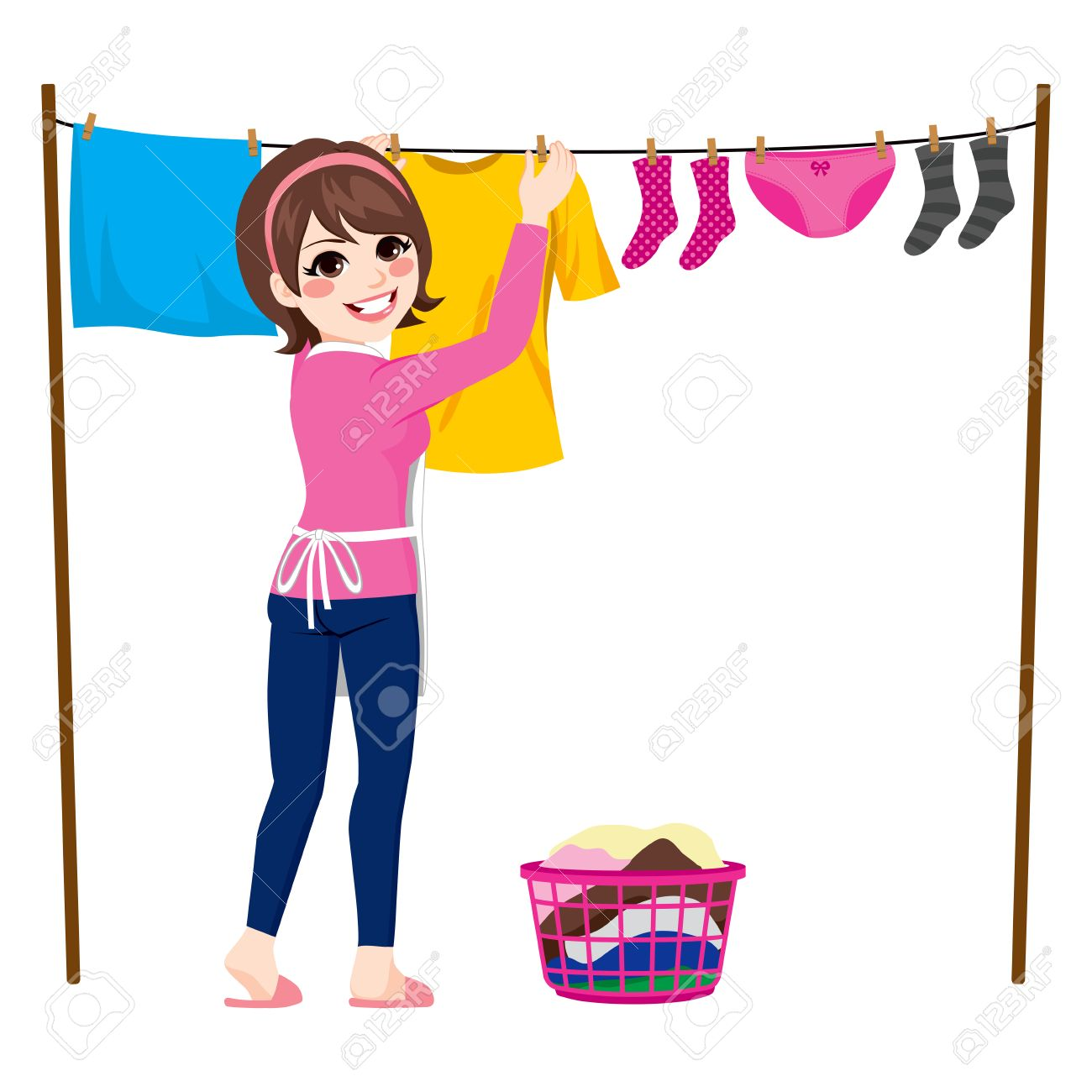 Happy young woman hanging wet clothes out to dry.