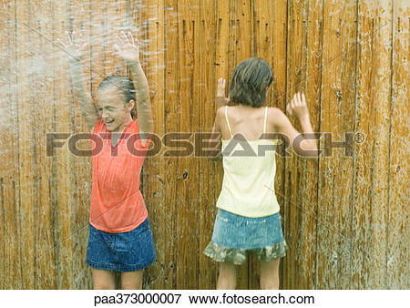 Picture of Girls standing in spray getting wet paa373000007.