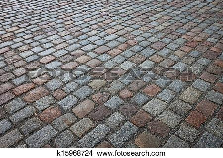 Stock Photo of Old wet stone paved avenue street road k15968724.