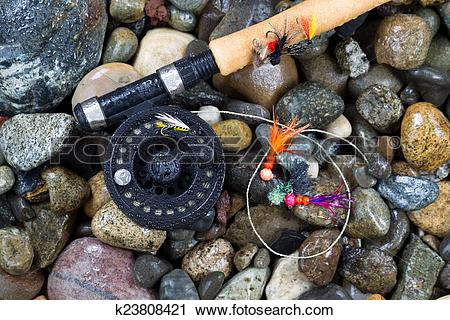 Stock Photography of Fly Fishing Pole and Reel with Flies on Wet.