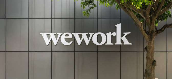 WeWork pwner We Company pushes back IPO amid investors.